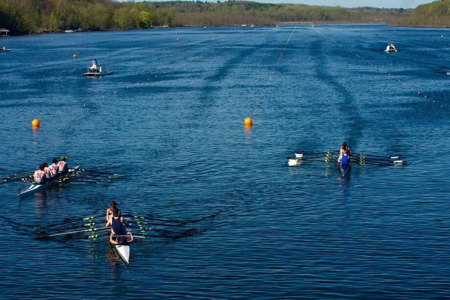 Lise Hafner captures the action during the recent New York State Scholastic Section 2 Championships held on Saratoga Lake. Niskayuna, on the left, took second place and Saratoga, in the center, took first place. Shaker took third place in the boys? freshmen quad race finalout of six boats, said Hafner, whose son rows for Shake