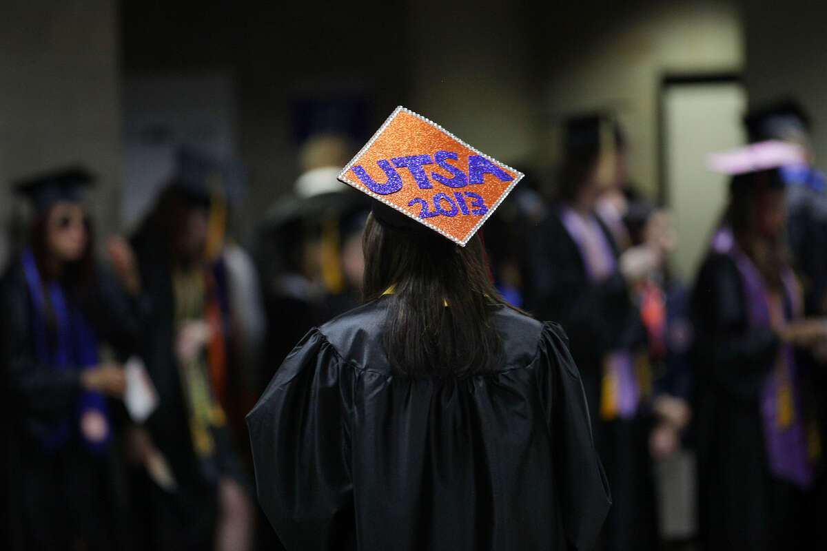 Briana Nicole Collazo, 24, decorates her cap for the first of two University of Texas at San Antonio graduation ceremonies at the Alamodome, Monday, May 13, 2013.