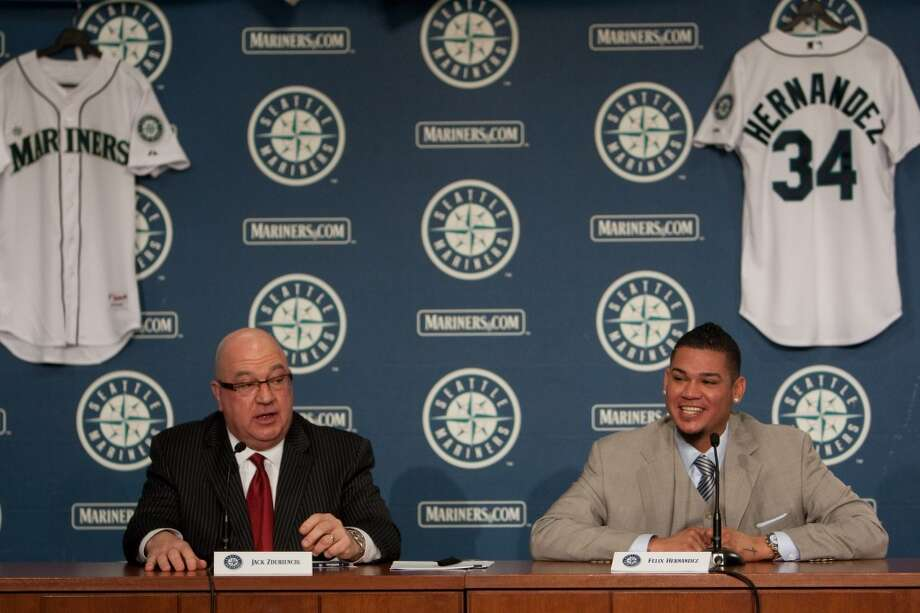 Felix Hernandez speaks as he signs a 7 year deal with Mariners General Manger Jack Zduriencik on Wednesday, February 13, 2013 at Safeco Field in Seattle.