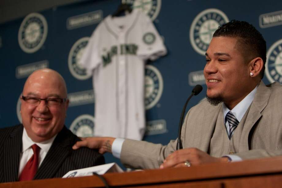 Seattle Mariner Felix Hernandez signs a 7 year deal with Mariners General Manger Jack Zduriencik on Wednesday, February 13, 2013 at Safeco Field in Seattle.