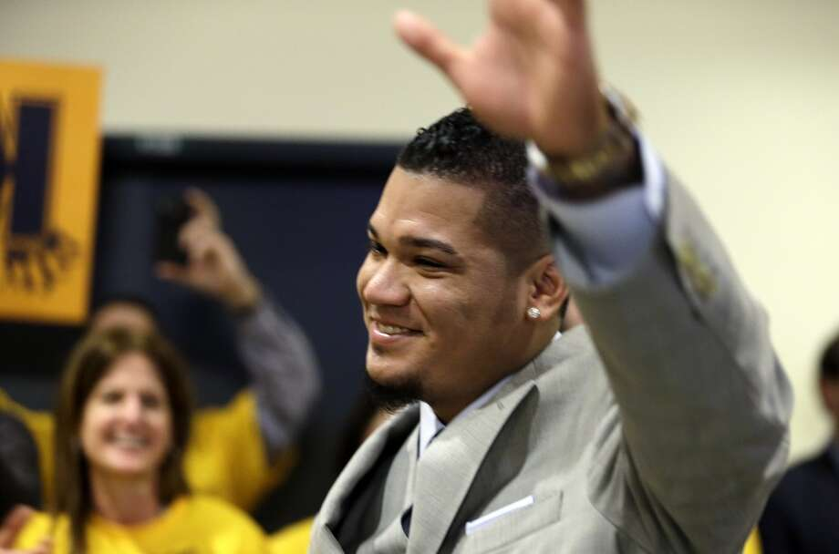Seattle Mariners' Felix Hernandez waves to team and stadium employees who greeted him before a news conference Wednesday, Feb. 13, 2013, in Seattle. Hernandez signed a seven-year contract with the Mariners that makes him the highest-paid pitcher in baseball, a new deal that will be worth $175 million. The contract covers the final two years of his current deal that was scheduled to run through the 2014 season and adds five additional years through the 2019 season.