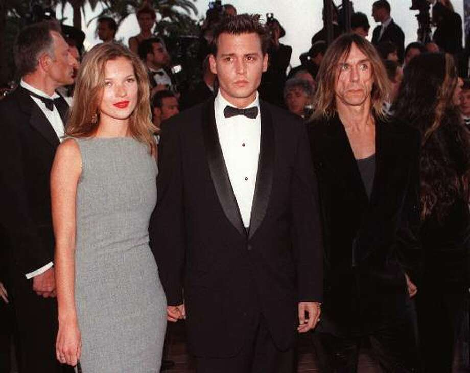 """US movie star Johnny Depp arrives with British top model Kate Moss and US rock star Iggy Pop at the Festival Palace in Cannes on Saturday May 10, 1997 to attend the screening of his first movie as director """"The Brave"""" which is presented today to the jury of the 50 International Cannes Film festival. The  music of """"The Brave"""" was composed by Iggy Pop. Photo: Remy De La Mauviniere, ASSOCIATED PRESS / AP1997"""
