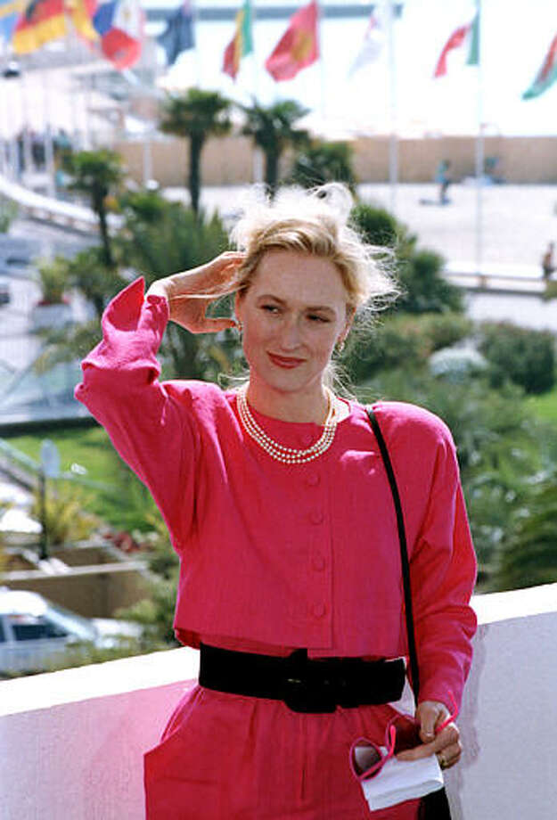 """American actress Meryl Streep puts her hair back as she poses on the terrace of the Festival Palace, during the Film Festival in Cannes, France, on May 13, 1989. Streep is promoting her recent picture """"A Cry in the Dark."""" Photo: Gilbert Tourte, ASSOCIATED PRESS / AP1989"""