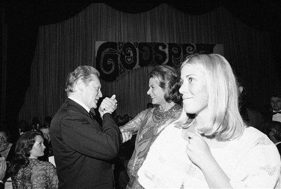"""French Culture Minister Maurice Druon, left, welcomes actress Ingrid Bergman, president of the jury of the Cannes Film Festival, and American actress Robin Lamont, right, """"Godspell"""" which opened the 26th Cannes International Film Festival, as they arrive at the Festival Palace for the opening gala in Cannes, May 11, 1973. Photo: Jean-Jacques Levy, ASSOCIATED PRESS / AP1973"""
