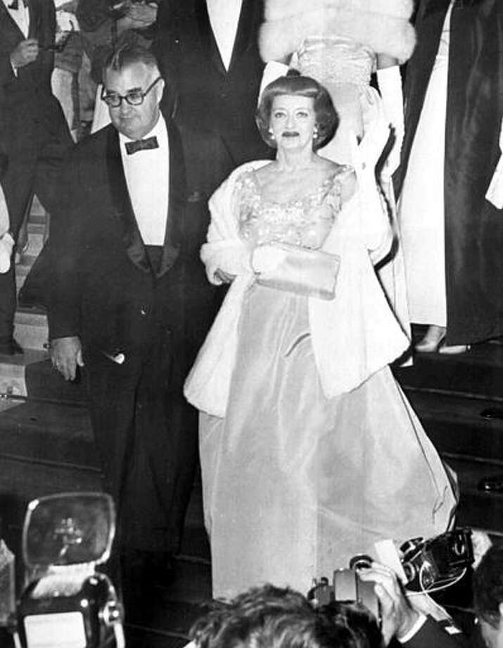 "American film director Robert Aldrich accompanies American film actress Bette Davis from the Festival Theater, in Cannes, France, May 11, 163, after the screening of their film ""What Ever Happened to Baby Jane?"" Photo: ASSOCIATED PRESS / AP1963"