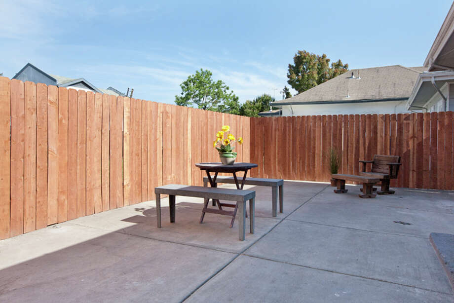 The property includes a private fenced-in patio. This neighborhood is said to be one of East Bay's most popular. Photo: © Kiera Condrey