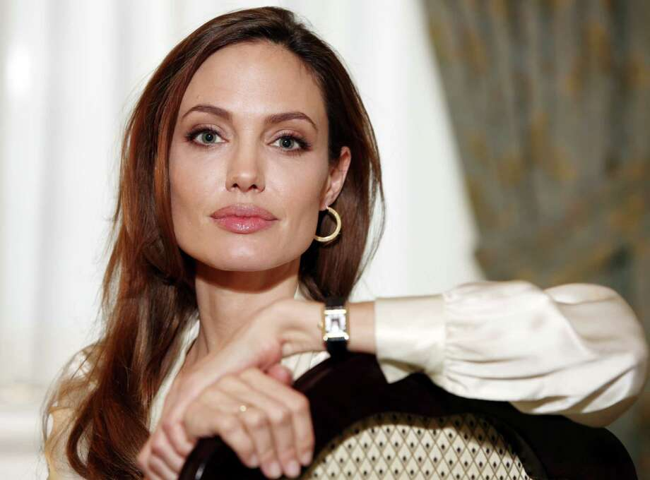 Though Team Jennifer might disagree, there are some similarities between Angelina and Elizabeth. Most noticeable: those soulful, sultry eyes. Photo: Carlo Allegri