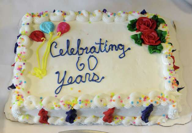 Cake for 80-year-old nurse Esther Rappold who was recognized for 60 years of work at Albany Memorial Hospital on Monday, May 13, 2013 in Albany, N.Y. (Lori Van Buren / Times Union) Photo: Lori Van Buren / 00022369A
