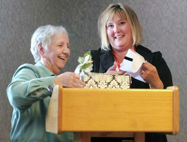80-year-old nurse Esther Rappold recieves a new nurse hat from case management coordinator Karen Julian as she is recognized for 60 years of work at Albany Memorial Hospital on Monday, May 13, 2013 in Albany, N.Y. (Lori Van Buren / Times Union) Photo: Lori Van Buren / 00022369A