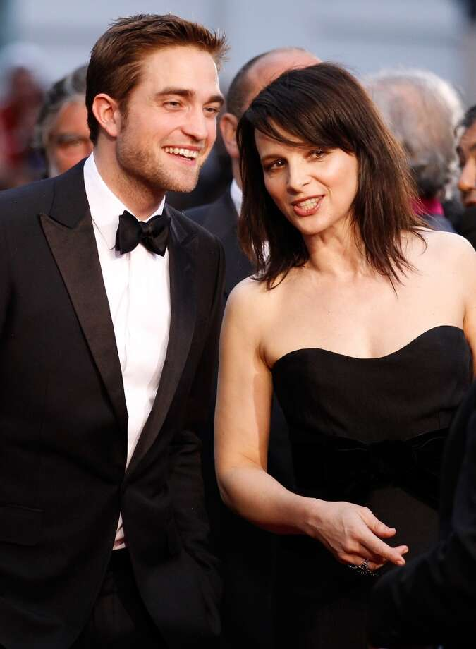 "Actors Juliet Binoche and Robert Pattinson attend the ""Cosmopolis"" premiere during the 65th Annual Cannes Film Festival at Palais des Festivals on May 25, 2012 in Cannes, France. Photo: Andreas Rentz, Getty Images"