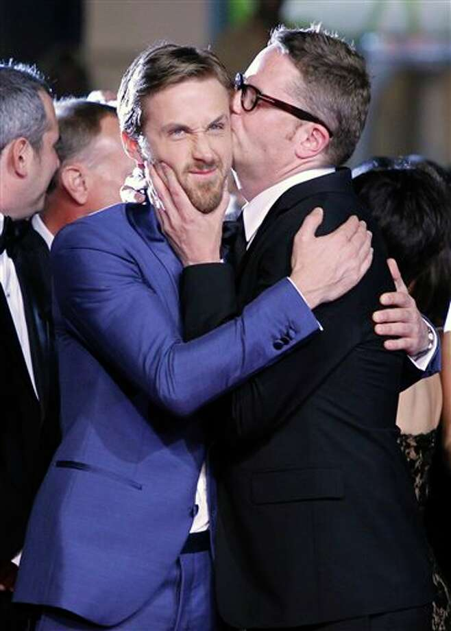 Director Nicolas Winding Refn, right, kisses actor Ryan Gosling on the cheek during arrivals for the screening of Drive at the 64th international film festival, in Cannes, southern France, Friday, May 20, 2011. Photo: Joel Ryan, AP / 2011 AP