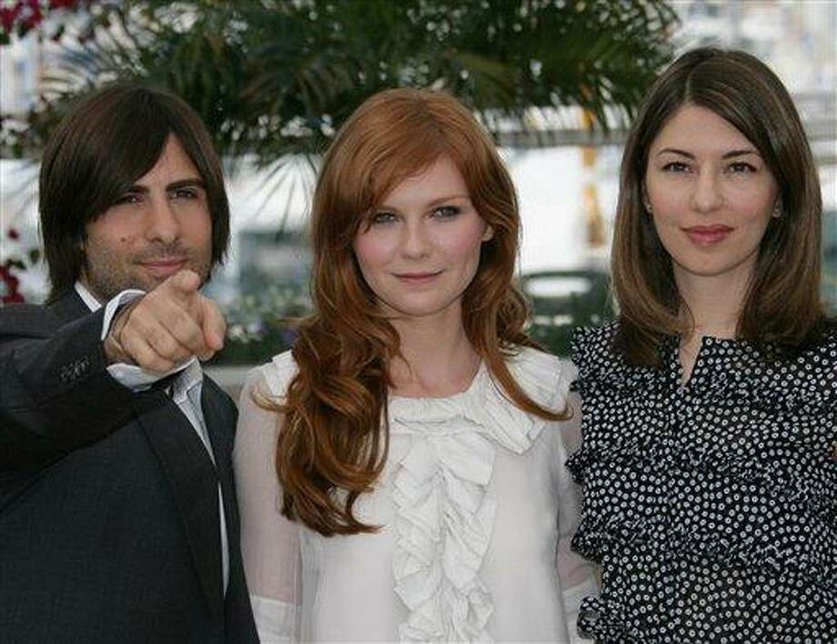 "American actor Jason Schwartzman, left, American actress Kirsten Dunst, center, and American director Sofia Coppola pose during a photo call for the film ""Marie-Antoinette,"" at the 59th International film festival in Cannes, southern France, on Wednesday, May 24, 2006. Photo: Francois Mori, ASSOCIATED PRESS / AP2006"