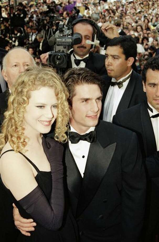 Actor Tom Cruise, center, arrives with Nicole Kidman, left, at the Cannes Film Festival Palace for the presentation of Ron Howards film Far and Away in which Cruise and Kidman star, at the 45th Cannes Film Festival, Monday, May 18, 1992, Cannes, France. Far and Away was out of competition and presented to close the 45th Cannes Film Festival. Photo: Rhonda Birndorf, ASSOCIATED PRESS / AP1992