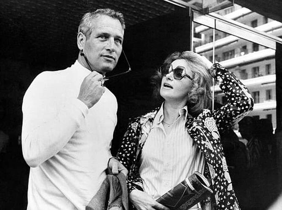 "Paul Newman and his actress-wife Joanne Woodward are seen in Cannes, France, May 23, 1973, where they present their joint motion picture ""The Effect of Gamma Rays on Man-in-the-Moon Marigolds"" during the International Cannes Film Festival. Newman directed the film after the Pulitzer Prize-winning play by Paul Zindel, with Woodward starring in the leading role. Photo: ASSOCIATED PRESS / AP1973"
