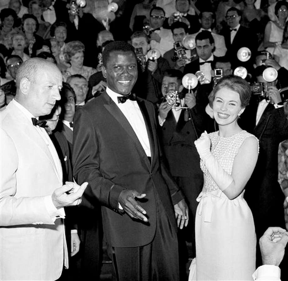 "Actor Sidney Poitier appears at the Cannes Film Festival, Cannes, France, for the showing of his film ""A Raisin in the Sun,"" May 13, 1961.  At right is actress Jean Seberg. Photo: Anonymous, ASSOCIATED PRESS / AP1961"