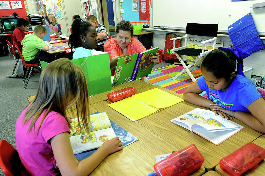 Gayle Lightfoot works with Jalaina Harris, 8, during Social Studies at Silsbee's Read-Turrentine Elementary School on Monday. With a 13-vote loss, Silsbee voters turned down Saturday a $29 million bond that would replace the aging elementary schools and benefit the middle and high schools.  Photo taken Monday, April 13, 2013 Guiseppe Barranco/The Enterprise Photo: Guiseppe Barranco, STAFF PHOTOGRAPHER / The Beaumont Enterprise