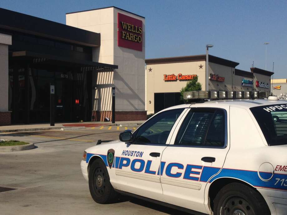 Bank workers were tied up and locked in a vault during a robbery at a Wells Fargo bank at 5175 W. 34th St.