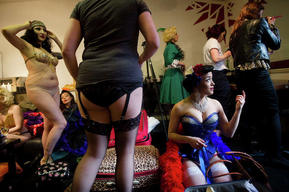 Burlesque performers prepare backstage at the London Burlesque Festival, May 11, 2013, in London, England. Now in its 7th year, Chaz Royal's London Burlesque Festival showcases some of the most eclectic and diverse acts in burlesque. The burlesque phenomenon that appeared in New York and London soon after the turn of the century has since proven to be more than just a retro revival, with no shortage of artists or fans. Photo: Warrick Page, Getty Images / 2013 Warrick Page