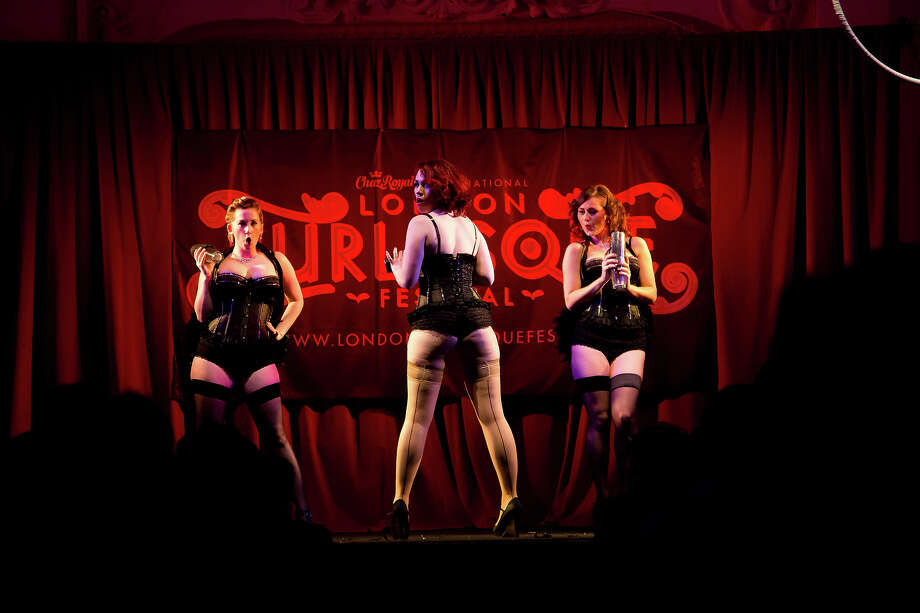 Burlesque artists perform on stage at the London Burlesque Festival, May 11, 2013, in London, England. Now in its 7th year, Chaz Royal's London Burlesque Festival showcases some of the most eclectic and diverse acts in burlesque. The burlesque phenomenon that appeared in New York and London soon after the turn of the century has since proven to be more than just a retro revival, with no shortage of artists or fans. Photo: Warrick Page, Getty Images / 2013 Warrick Page