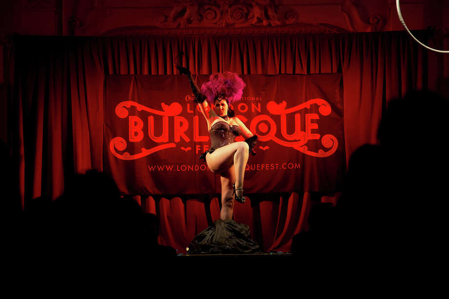 A burlesque artist performs on stage at the London Burlesque Festival, May 11, 2013, in London, England. Now in its 7th year, Chaz Royal's London Burlesque Festival showcases some of the most eclectic and diverse acts in burlesque. The burlesque phenomenon that appeared in New York and London soon after the turn of the century has since proven to be more than just a retro revival, with no shortage of artists or fans. Photo: Warrick Page, Getty Images / 2013 Warrick Page