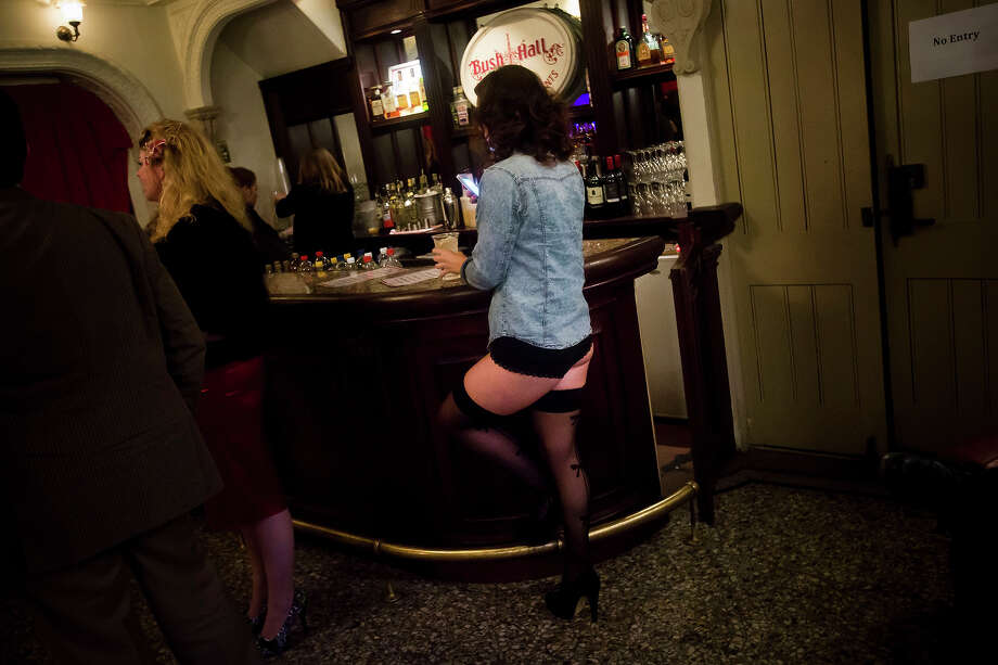 A burlesque performer stands at the bar in her underwear during intermission  at the London Burlesque Festival, May 11, 2013, in London, England. Now in its 7th year, Chaz Royal's London Burlesque Festival showcases some of the most eclectic and diverse acts in burlesque. The burlesque phenomenon that appeared in New York and London soon after the turn of the century has since proven to be more than just a retro revival, with no shortage of artists or fans. Photo: Warrick Page, Getty Images / 2013 Warrick Page