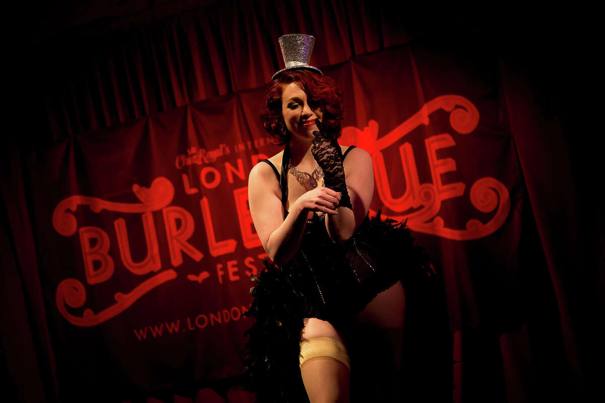 A burlesque artist performs her routine at the London Burlesque Festival, May 11, 2013, in London, England. Now in its 7th year, Chaz Royal's London Burlesque Festival showcases some of the most eclectic and diverse acts in burlesque. The burlesque phenomenon that appeared in New York and London soon after the turn of the century has since proven to be more than just a retro revival, with no shortage of artists or fans.