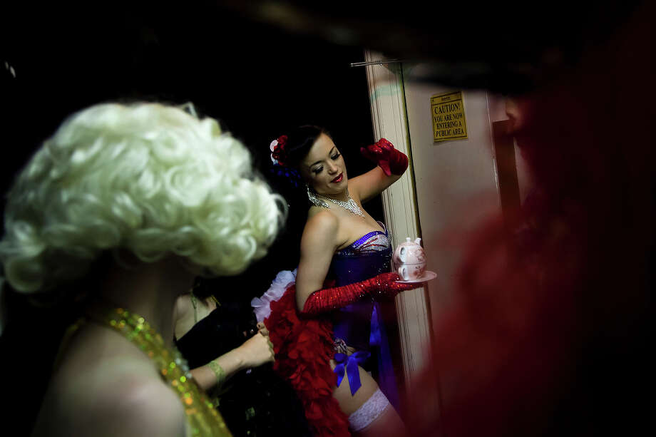 Burlesque performers prepare to go on stage at the London Burlesque Festival, May 11, 2013, in London, England. Now in its 7th year, Chaz Royal's London Burlesque Festival showcases some of the most eclectic and diverse acts in burlesque. The burlesque phenomenon that appeared in New York and London soon after the turn of the century has since proven to be more than just a retro revival, with no shortage of artists or fans. Photo: Warrick Page, Getty Images / 2013 Warrick Page