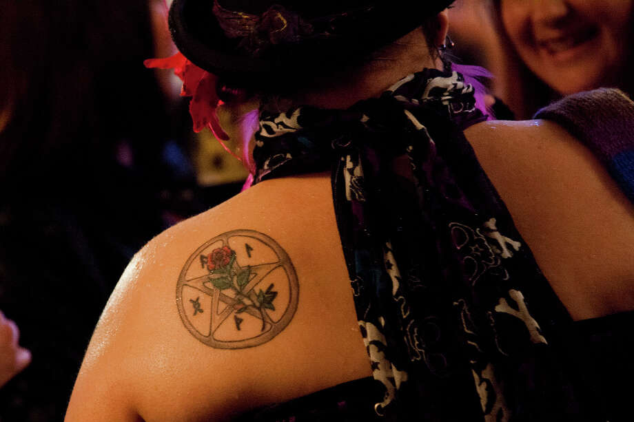 A tattoo of a pentagram adorns the shoulder of an audience member at the London Burlesque Festival, May 11, 2013, in London, England. Now in its 7th year, Chaz Royal's London Burlesque Festival showcases some of the most eclectic and diverse acts in burlesque. The burlesque phenomenon that appeared in New York and London soon after the turn of the century has since proven to be more than just a retro revival, with no shortage of artists or fans. Photo: Warrick Page, Getty Images / 2013 Warrick Page