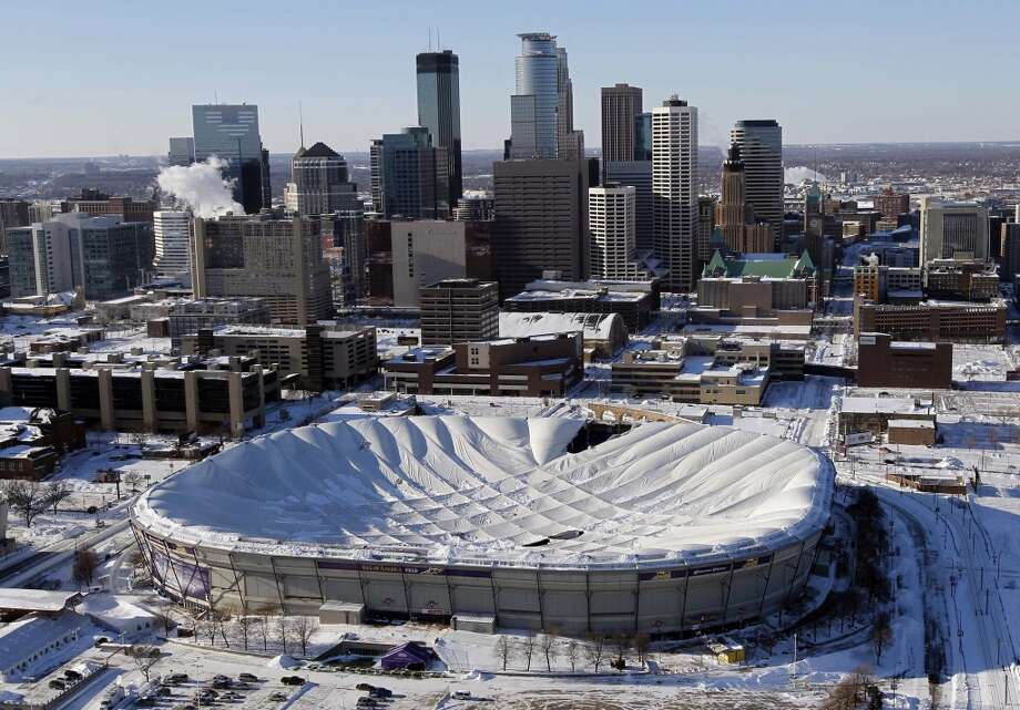 The inflatable roof of the Metrodome collapsed Dec. 12, 2010, after a snowstorm that dumped 17 inches on Minneapolis. No one was hurt, but the roof failure sent the NFL scrambling to find a new venue for the Vikings' remaining home games during that season. Photo: Ann Heisenfelt, Associated Press