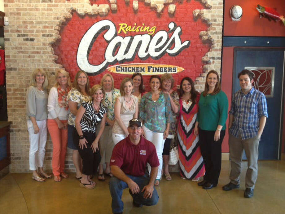 These select teachers from Stone Oak Elementary School were recipients of a Learning Zone gift card from Raising Cane's restaurant. They're pictured at the chain's new Stone Oak restaurant. Photo: Courtesy Photo