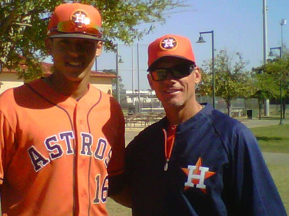From one great infielder to hopefully another, Biggio talks with shortstop prospect Carlos Correa during spring training. Biggio serves as a special assistant to general manager Jeff Luhnow. Photo: Jose De Jesus Ortiz, Chronicle