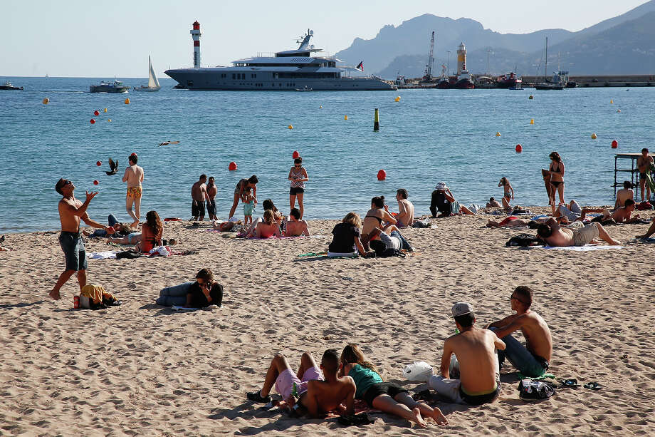 People enjoy the beach on May 13, 2013 in Cannes, two days before the opening of  the 66th Cannes Film Festival. Photo: LOIC VENANCE, AFP/Getty Images / 2013 AFP