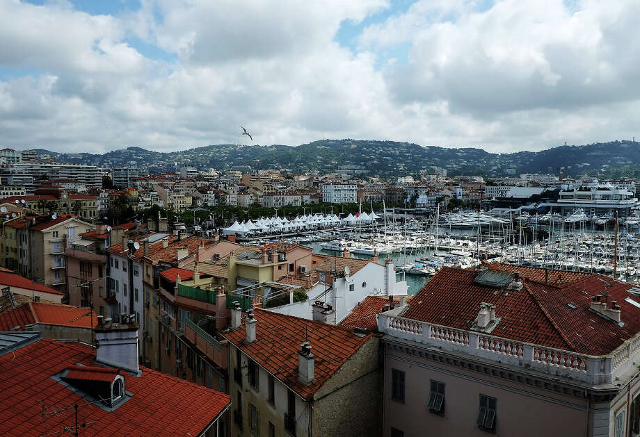 View of rooftops and the port of Cannes ahead of the 66th edition of the Cannes Film Festival in Cannes on May 14, 2013. Cannes, one of the world's top film festivals, opens on May 15 and will climax on May 26 with awards selected by a jury headed this year by Hollywood legend Steven Spielberg. Photo: ALBERTO PIZZOLI, AFP/Getty Images / 2013 AFP