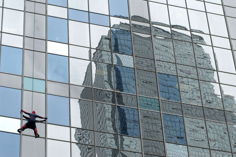 "Renaissance Towerin downtown Dallas: 886 feet, 56 stories   Pictured: Rich Hopkins dressed as ""Spider-Man"" climbs down the side Thursday, Oct. 31, 2002. Photo: JON FREILICH, AP / AP"