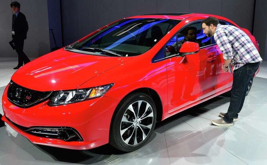 """5. Honda Civic Si  What Edmunds.com says: """"Just one year after the model's poorly received redesign, the 2013 Honda Civic benefits from a significant refresh that should help restore its luster in the competitive compact-car category.""""See all the rankings here Photo: FREDERIC J. BROWN, File / AFP"""