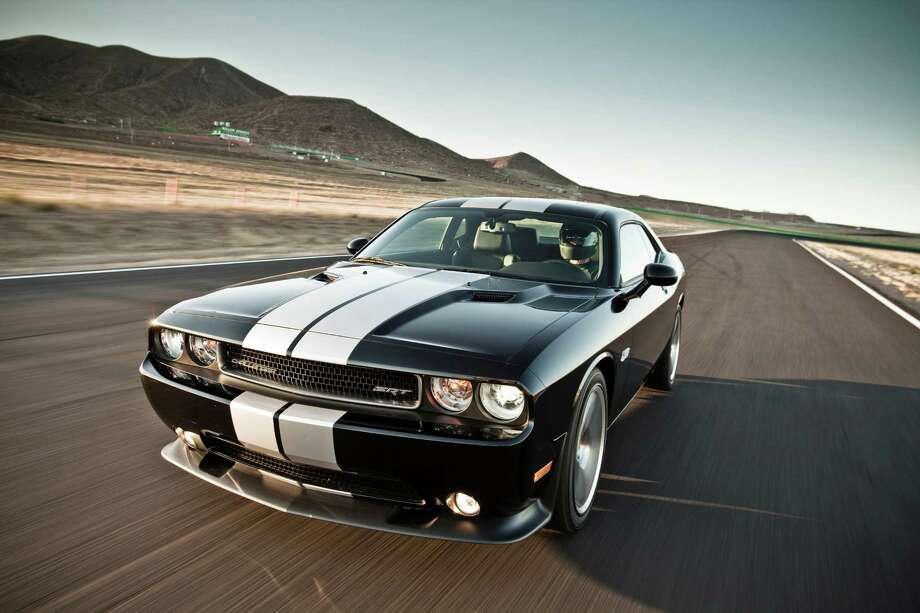 "8. Dodge Challenger What Edmunds.com says: ""The 2013 Dodge Challenger is sure to delight muscle car fanatics with its power and attitude, while winning over more fans with its civilized road manners and higher levels of comfort.""See all the rankings here Photo: Handout, File / Dodge"