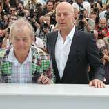 Bruce Willis and Bill Murray pose at the 'Moonrise Kingdom' photocall during the 65th Annual Cannes Film Festival at Palais des Festivals on May 16, 2012 in Cannes, France.