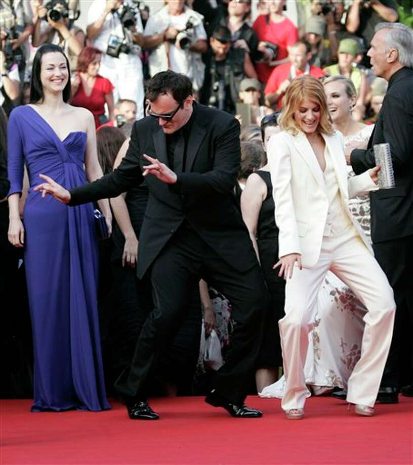 American director Quentin Tarantino, left, and cast member French actress Melanie Laurent dance on the red carpet as they arrive for the screening of the film 'Inglourious Basterds' during the 62nd International film festival in Cannes, southern France, Wednesday, May 20, 2009. Photo: Francois Mori, ASSOCIATED PRESS / AP2009