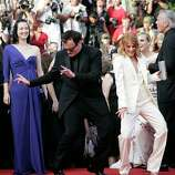 American director Quentin Tarantino, left, and cast member French actress Melanie Laurent dance on the red carpet as they arrive for the screening of the film 'Inglourious Basterds' during the 62nd International film festival in Cannes, southern France, Wednesday, May 20, 2009.