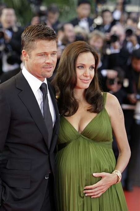 """In this May 15, 2008 file photo, U.S. actors Brad Pitt, left, and Angelina Jolie arrive for the premiere of the film """"Kung Fu Panda,"""" during the 61st International film festival in Cannes, France. Photo: Matt Sayles, ASSOCIATED PRESS / AP2008"""