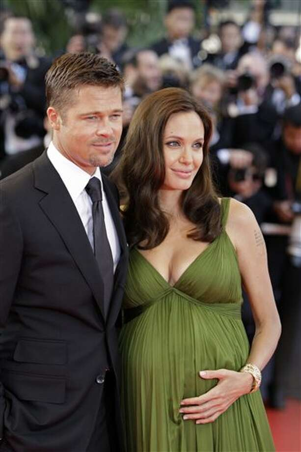 "In this May 15, 2008 file photo, U.S. actors Brad Pitt, left, and Angelina Jolie arrive for the premiere of the film ""Kung Fu Panda,"" during the 61st International film festival in Cannes, France. Photo: Matt Sayles, ASSOCIATED PRESS / AP2008"