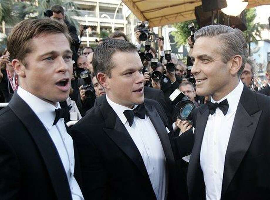 "American actors from left to right, Brad Pitt, Matt Damon and George Clooney arrive for the screening of the film ""Ocean's Thirteen,"" at the 60th International film festival in Cannes, southern France, on Thursday, May 24, 2007. Photo: Francois Mori, ASSOCIATED PRESS / AP2007"
