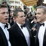 "American actors from left to right, Brad Pitt, Matt Damon and George Clooney arrive for the screening of the film ""Ocean's Thirteen,"" at the 60th International film festival in Cannes, southern France, on Thursday, May 24, 2007."
