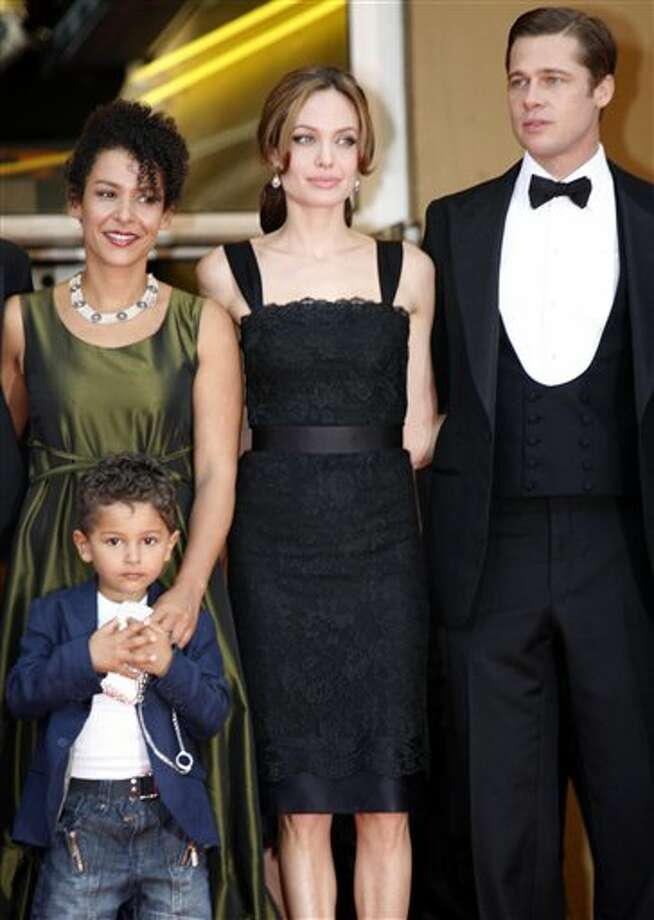"From left, Mariane Pearl, wife of slain journalist Daniel Pearl, her son Adam, and American actors Angelina Jolie and Brad Pitt stand at the top of the red carpet during arrivals for the screening of the film ""A Mighty Heart,"" at the 60th International film festival in Cannes, southern France, on Monday, May 21, 2007. Photo: Andrew Medichini, ASSOCIATED PRESS / AP2007"