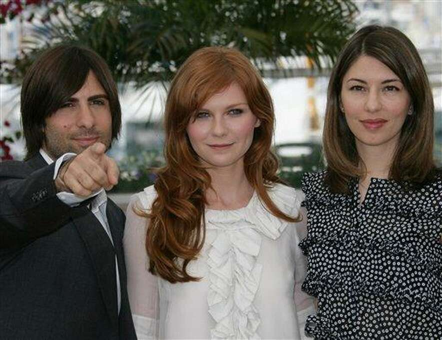 """American actor Jason Schwartzman, left, American actress Kirsten Dunst, center, and American director Sofia Coppola pose during a photo call for the film """"Marie-Antoinette,"""" at the 59th International film festival in Cannes, southern France, on Wednesday, May 24, 2006. Photo: Francois Mori, ASSOCIATED PRESS / AP2006"""