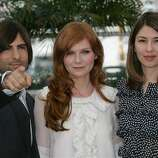 "American actor Jason Schwartzman, left, American actress Kirsten Dunst, center, and American director Sofia Coppola pose during a photo call for the film ""Marie-Antoinette,"" at the 59th International film festival in Cannes, southern France, on Wednesday, May 24, 2006."