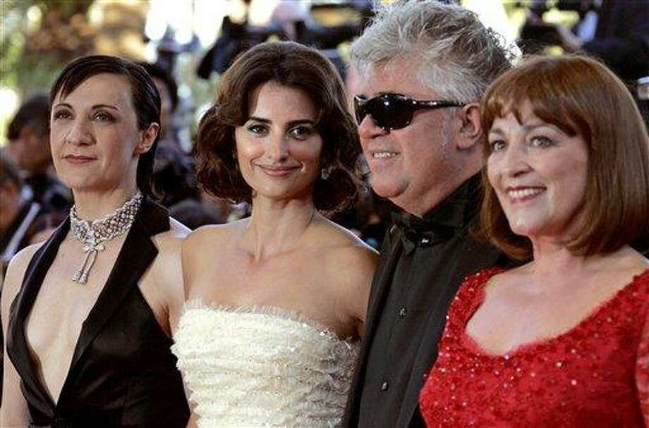 """From left, Spanish actress Blanca Portillo, Spanish actress Penelope Cruz, Spanish director Pedro Almodovar, and Spanish actress Carmen Maura arrive for the screening of the film """"Volver,"""" at the 59th International film festival in Cannes, southern France, on Friday, May 19, 2006. Photo: Kirsty Wigglesworth, ASSOCIATED PRESS / AP2006"""