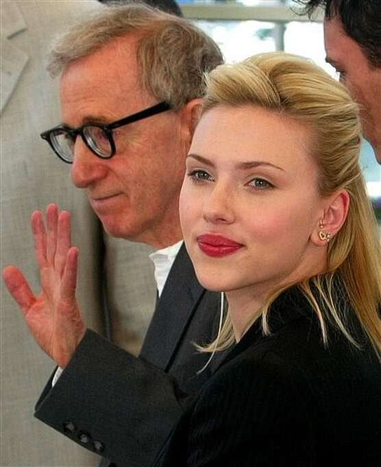 """American director Woody Allen poses for photographers with his American actress Scarlett Johansson during a photo call for his film """"Match Point"""" out of competition, at the 58th international Cannes film festival, southern France, Thursday, May 12, 2005. Photo: Lionel Cironneau, ASSOCIATED PRESS / AP2005"""