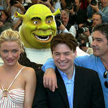 "American actress Cameron Diaz, left, Canadian actor Mike Myers, center, and Spanish actor Antonio Banderas, right, pose while a man in a Shrek costume stands behind, during a photocall for their animated film ""Shrek 2,""in competition, Saturday, May 15, 2004."