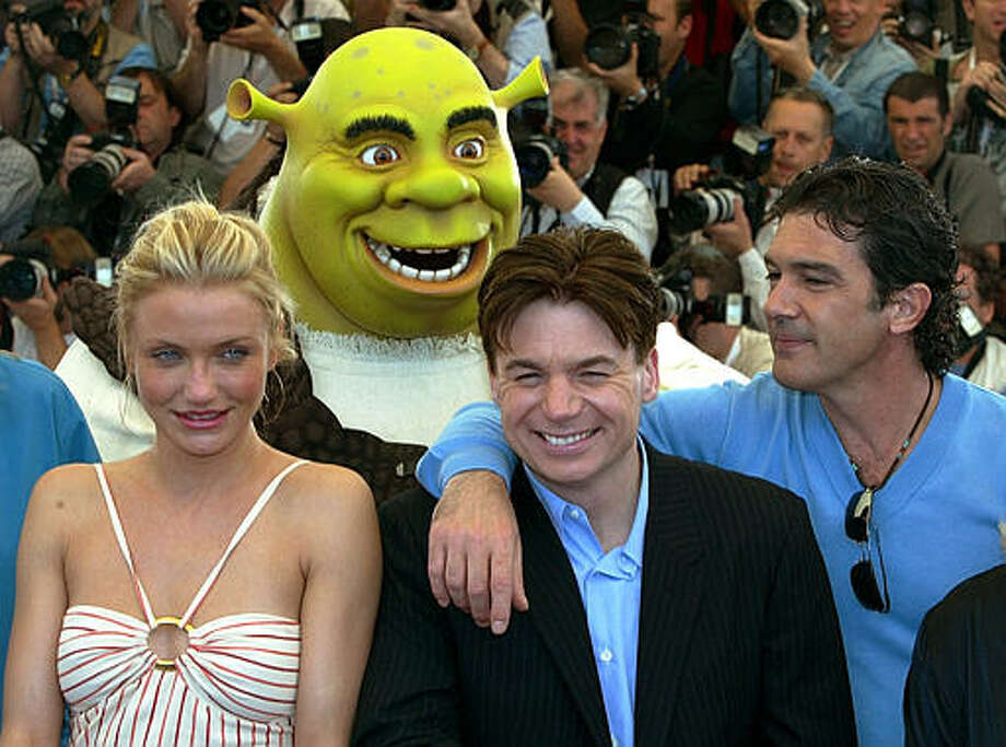 "American actress Cameron Diaz, left, Canadian actor Mike Myers, center, and Spanish actor Antonio Banderas, right, pose while a man in a Shrek costume stands behind, during a photocall for their animated film ""Shrek 2,""in competition, Saturday, May 15, 2004. Photo: Michel Euler, ASSOCIATED PRESS / AP2004"